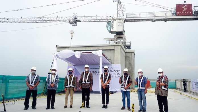 Topping off Cha Tower Sayana Apartments